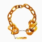 Impress Me chain necklace, amber resin rings with hanging drop motif and zinc metal parts-