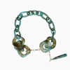 Resin chain necklace, green resin rings with hanging drop motif and zinc metal parts